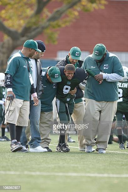Harlem Jets player walking off field with coach after sustaining injury during game vs Mill Basin Mariners at Harlem River Park New York NY CREDIT...