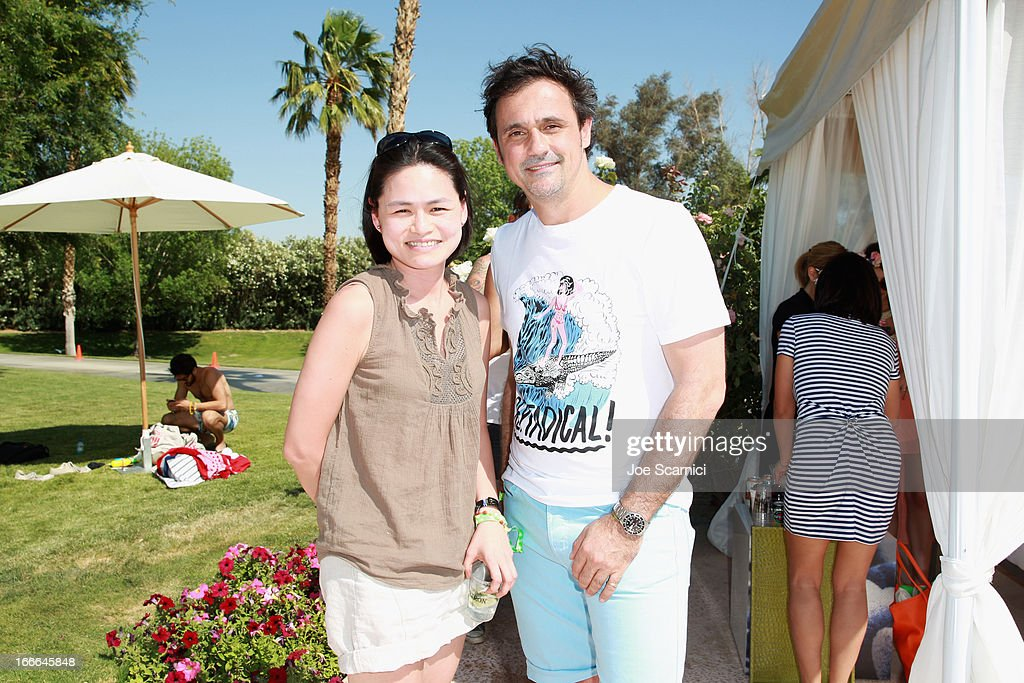 Peggy Ang from Samsung and LACOSTE CEO Francis Pierrel attend LACOSTE L!VE 4th Annual Desert Pool Party on April 14, 2013 in Thermal, California.