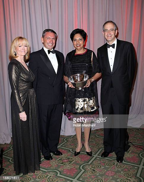 Peggy Conlon Andrew Robertson Indra K Nooyi and Brian Roberts attend the 58th annual Ad Council dinner at the Waldorf Astoria Hotel on November 16...