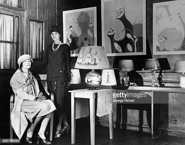 Peggy Guggenheim well known American society girl who recently joined the ranks of young American business women in Paris opened a lamp shop with the...