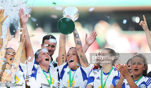 Peggy Kuznik of Frankfurt and her team mates celebrate winning with the trophy after the Women's DFB Cup Final between SGS Essen and 1 FFC Frankfurt...
