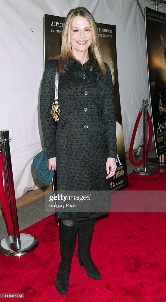 Peggy Lipton, wearing a coat designed by Donna Karan