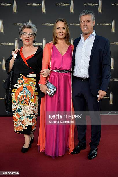 Peggy Lukac Jenny Juergens and Klaus Zmorek arrive at the 'Deutscher Fernsehpreis 2014' at Coloneum on October 2 2014 in Cologne Germany