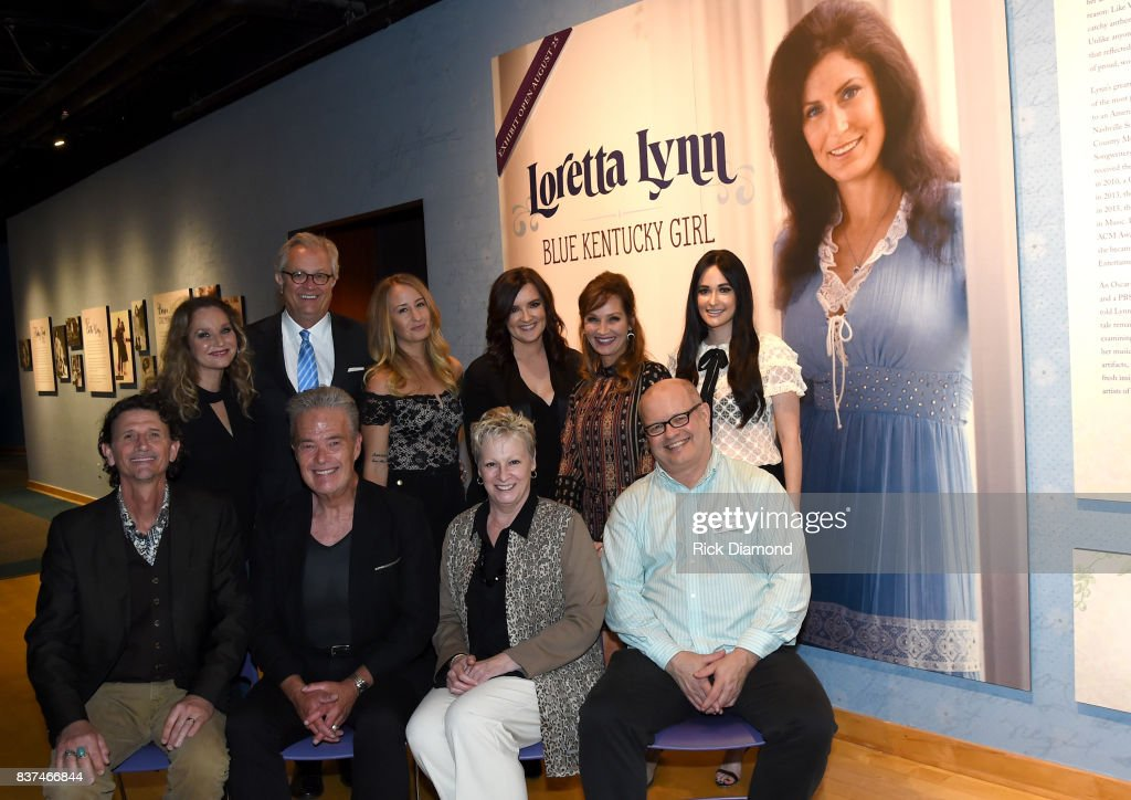Peggy Lynn, Country Music Hall of Fame and Museum's Kyle Young, Margo Price, Brandy Clark, Patsy Lynn Russell, Kacey Musgraves, (front row L-R) John Reed, Tim Cobb, Carolyn Tate, and Michael McCall attend the new exhibition Loretta Lynn: Blue Kentucky Girl at Country Music Hall of Fame and Museum on August 22, 2017 in Nashville, Tennessee.