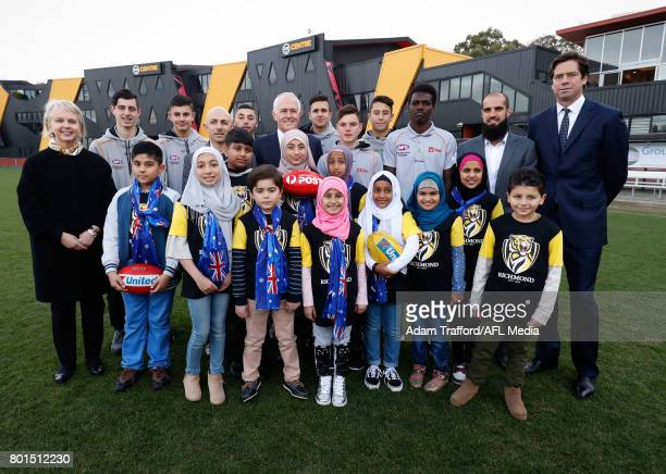 Peggy O'Neal President of the Tigers Gillon McLachlan Chief Executive Officer of the AFL Bachar Houli of the Tigers and Malcolm Turnbull Prime...