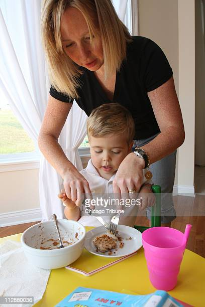 Peggy Pridemore's son Patrick was diagnosed with numerous food allergies Here she helps him cut homemade chicken tenders on Monday October 6 in...