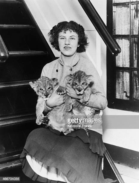 Peggy Salaman young English aviator with her two lion cubs at her arrival to Southampton after breaking a record flying from London to Cape Town on...
