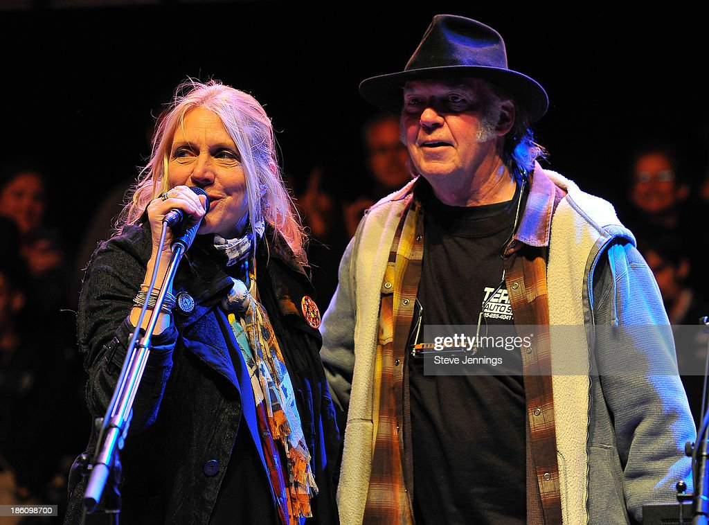 Pegi Young and Neil Young (L-R) perform on Day 2 of the 27th Annual Bridge School Benefit concert at Shoreline Amphitheatre on October 27, 2013 in Mountain View, California.