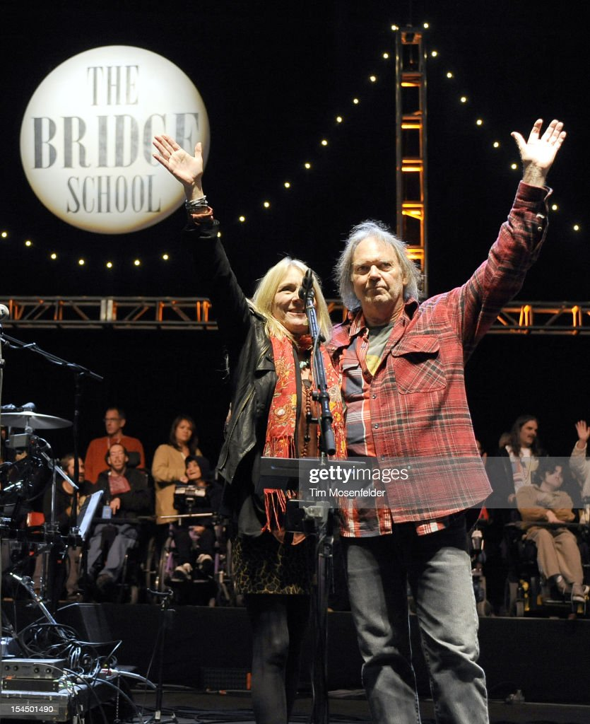 Pegi Young (L) and Neil Young perform the as part of the Finale at the 26th Annual Bridge School Benefit at Shoreline Amphitheatre on October 20, 2012 in Mountain View, California.