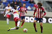 Peguy Luyindula New York Red Bulls is challenged by Agustin Pelletieri Chivas USA during the New York Red Bulls V Chivas USA Major League Soccer...