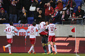 Peguy Luyindula New York Red Bulls is lifted by team mate Luis Robles after scoring a 94th minute equalizer during the New York Red Bulls V Chivas...