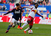 Peguy Luyindula of New York Red Bulls plays the ball against the New England Revolution during the Eastern Conference Final Leg 1 at Red Bull Arena...
