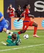 Peguy Luyindula of Paris Saint Germain is stopped on a diving save by goalkeeper Ross Turnbull of Chelsea FC during the match at Yankee Stadium on...