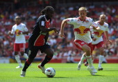 Peguy Luyindula of Paris St Germain is closed down by Jan Gunnar Solli of New York Red Bulls during the Emirates Cup match between New York Red Bulls...