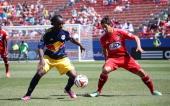 Peguy Luyindula of the New York Redbulls defends the ball against David Texeira of FC Dallas at Toyota Stadium in Frisco on May 4 2014 in Frisco Texas