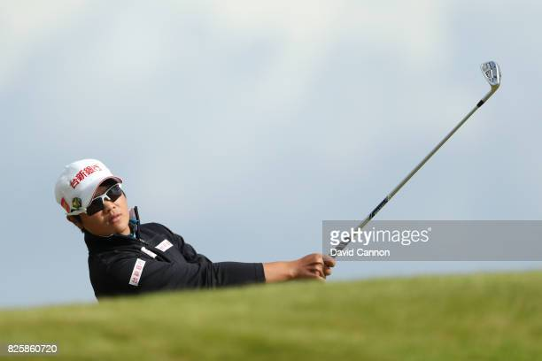 Pei Yan Chien of Chinese Taipei hits her second shot on the 4th hole during the first round of the Ricoh Women's British Open at Kingsbarns Golf...