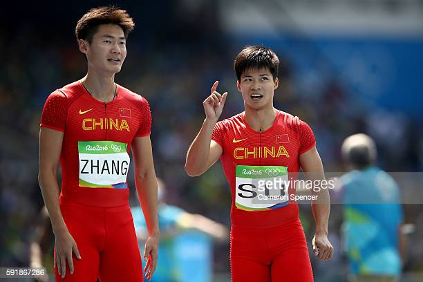Peimeng Zhang and Bingtian Su of China react in round one of the Men's 4 x 100m Relay on Day 13 of the Rio 2016 Olympic Games at the Olympic Stadium...