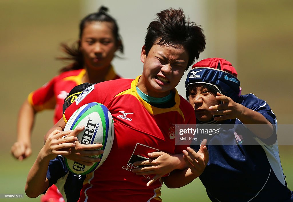 PeiPei Ren of China makes a break in the Women's Rugby Sevens during day three of the Australian Youth Olympic Festival at St Ignatius College on January 18, 2013 in Sydney, Australia.