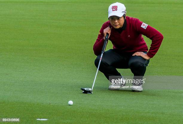 PeiYun Chien of Chinese Taipei lines up a putt during the Hyundai China Ladies Open 2014 on December 13 2014 at Mission Hills Shenzhen in Shenzhen...