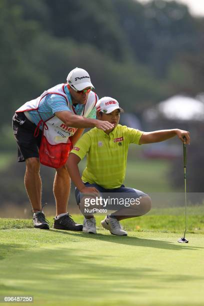 Peiyun Chien of Chinese Taipei lines up her putt on the 12th green during the first round of the Meijer LPGA Classic golf tournament at Blythefield...