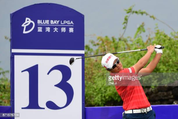 Peiyun Chien of Chinese Taiwan plays a shot on the 13th hole during the first round of the Blue Bay LPGA at Jian Lake Blue Bay golf course on...