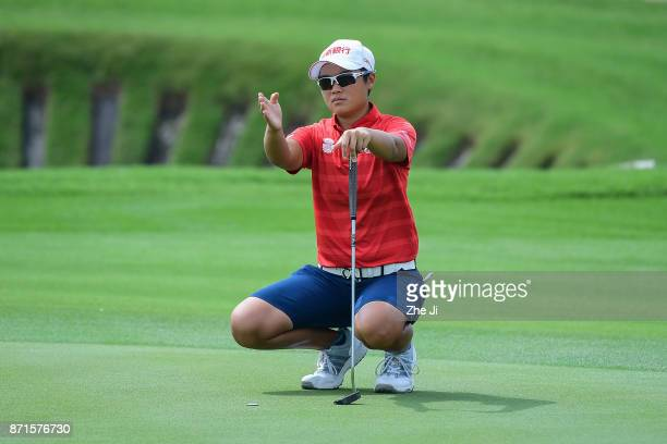 Peiyun Chien of Chinese Taiwan plays in action on the 12th hole during the first round of the Blue Bay LPGA at Jian Lake Blue Bay golf course on...