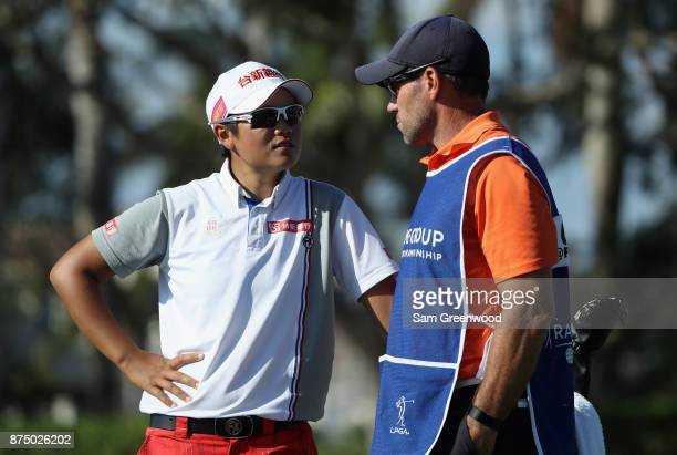 Peiyun Chien of Taiwan talks with her caddie on the ninth hole during round one of the CME Group Tour Championship at the Tiburon Golf Club on...