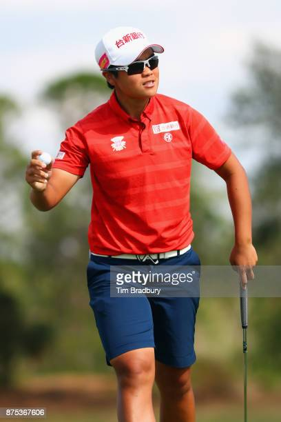 Peiyun Chien of Taiwan waves to the crowd after putting for birdie on the ninth green during round two of the CME Group Tour Championship at the...