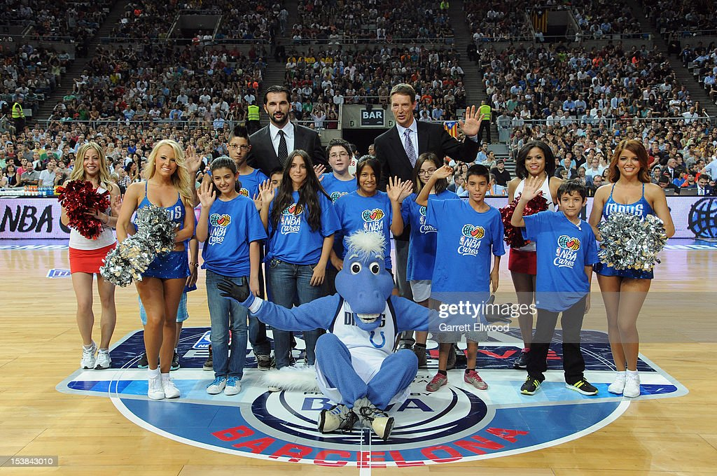 Peja Stojakovic and <a gi-track='captionPersonalityLinkClicked' href=/galleries/search?phrase=Detlef+Schrempf&family=editorial&specificpeople=209337 ng-click='$event.stopPropagation()'>Detlef Schrempf</a> smiles for the camera during a time out for NBA Cares in the game of the Dallas Mavericks against FC Barcelona Regal during NBA Europe Live 2012 on October 9, 2012 at Palau Sant Jordi in Barcelona, Spain.