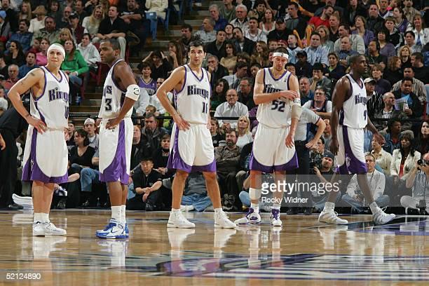 Peja Stojakovic Mike Bibby Cuttino Mobley Chris Webber and Brad Miller of the Sacramento Kings look on against the Portland Trail Blazers January18...