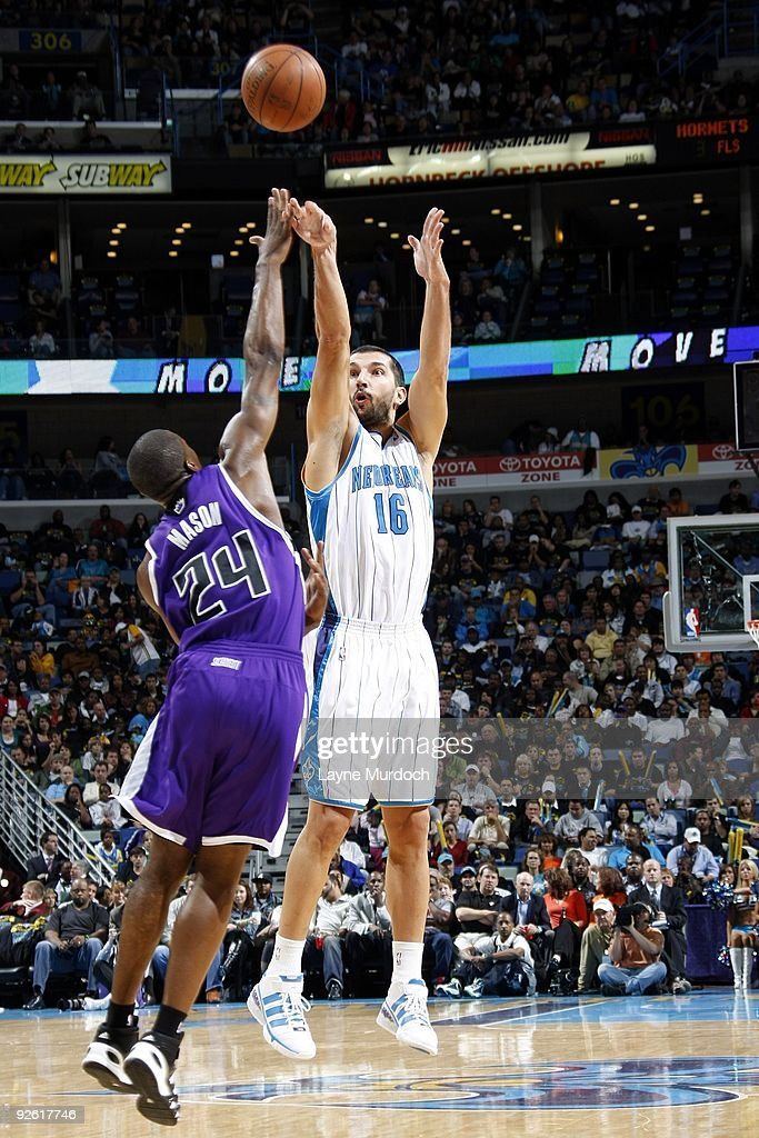 Peja Stojakovic of the New Orleans Hornets shoots a jump shot over Desmond Mason of the Sacramento Kings during the game against at New Orleans Arena...