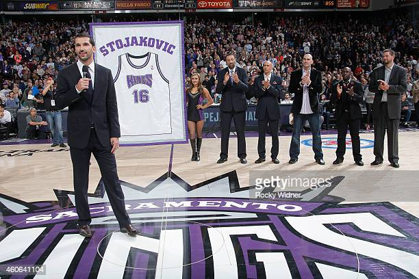 Peja Stojakovic waves to the fans as the Sacramento Kings retire his jersey during halftime against the Oklahoma City Thunder on December 16 2014 at...