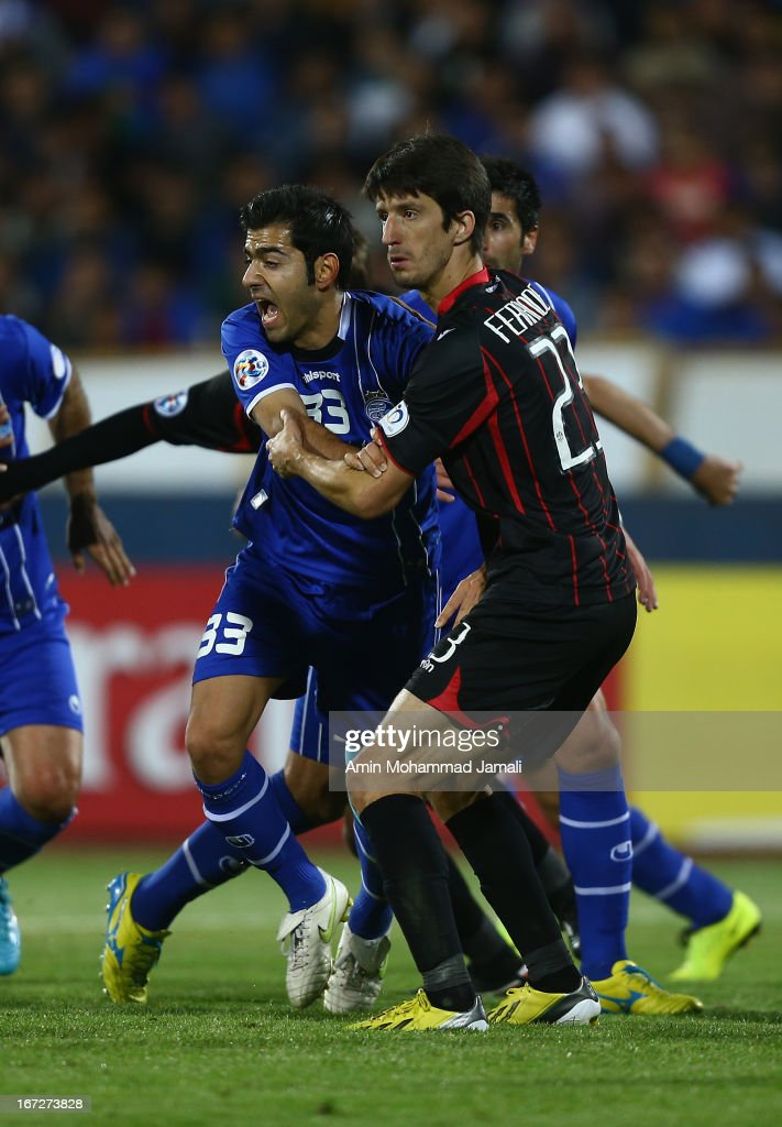 Pejman Montazeri and <a gi-track='captionPersonalityLinkClicked' href=/galleries/search?phrase=Alvaro+Fernandez&family=editorial&specificpeople=2946918 ng-click='$event.stopPropagation()'>Alvaro Fernandez</a> during the AFC Champions League Group D match between Esteghlal and Al Rayyan at Azadi Stadium on April 23, 2013 in Tehran, Iran.