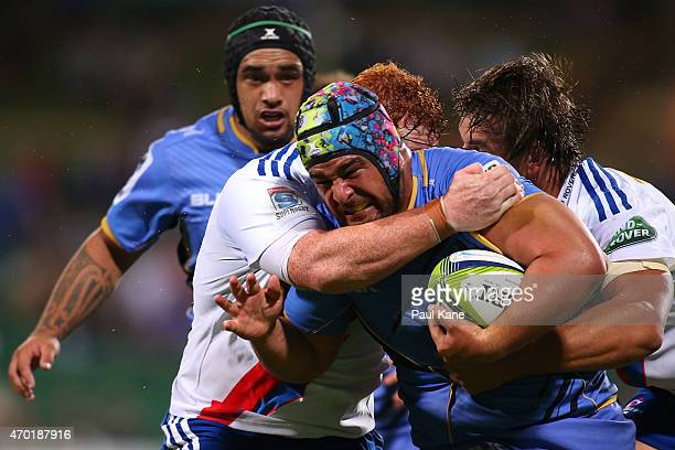 Pekahou Cowan of the Force attempts to break from a tackle by Steven Kitshoff of the Stormers during the round 10 Super Rugby match between the Force...