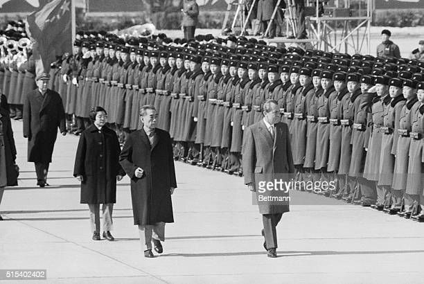 President Richard Nixon and Chinese Premier Chou Enlai review the Honor Guard following Nixon's arrival at Peking Airport