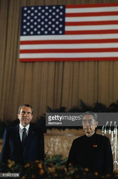 Peking China President Richard Nixon and Premier Chou EnLai stand at attention during the playing of both countries' national anthems at a state...