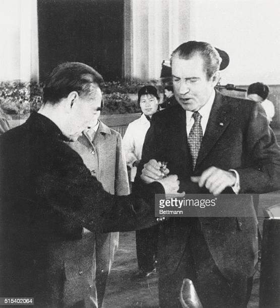 Toasting U S President Richard M Nixon and Communist Chinese Premier Chou EnLai prepare to drink toast during state banquet honoring the Nixons in...