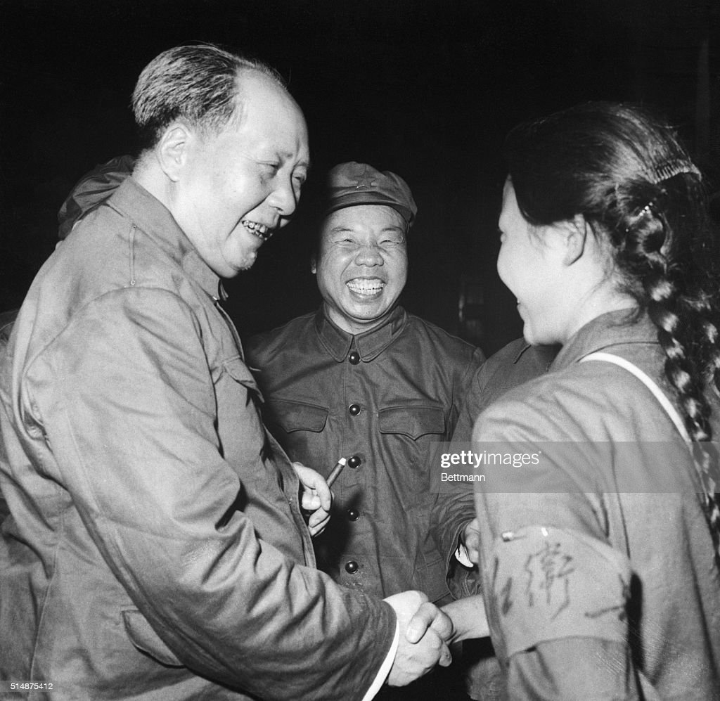 Communist China's Chairman Mao Tse-Tung has a big smile and a hearty handclasp for a pigtailed girl member of the Red Guard in Peking recently. A central committees directive, issued Sept. 6th, instructs the Red Guards to spread the 'Cultural Revolution' throughout rural areas but not to disrupt farm production in their zealous effort to 'Maotize' the nation. 9/28/1966