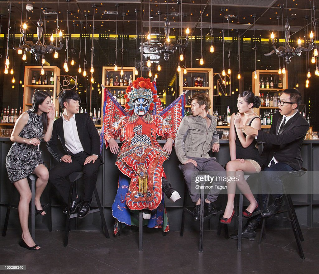 Peking Opera Character with Young people at a Bar : Stock Photo