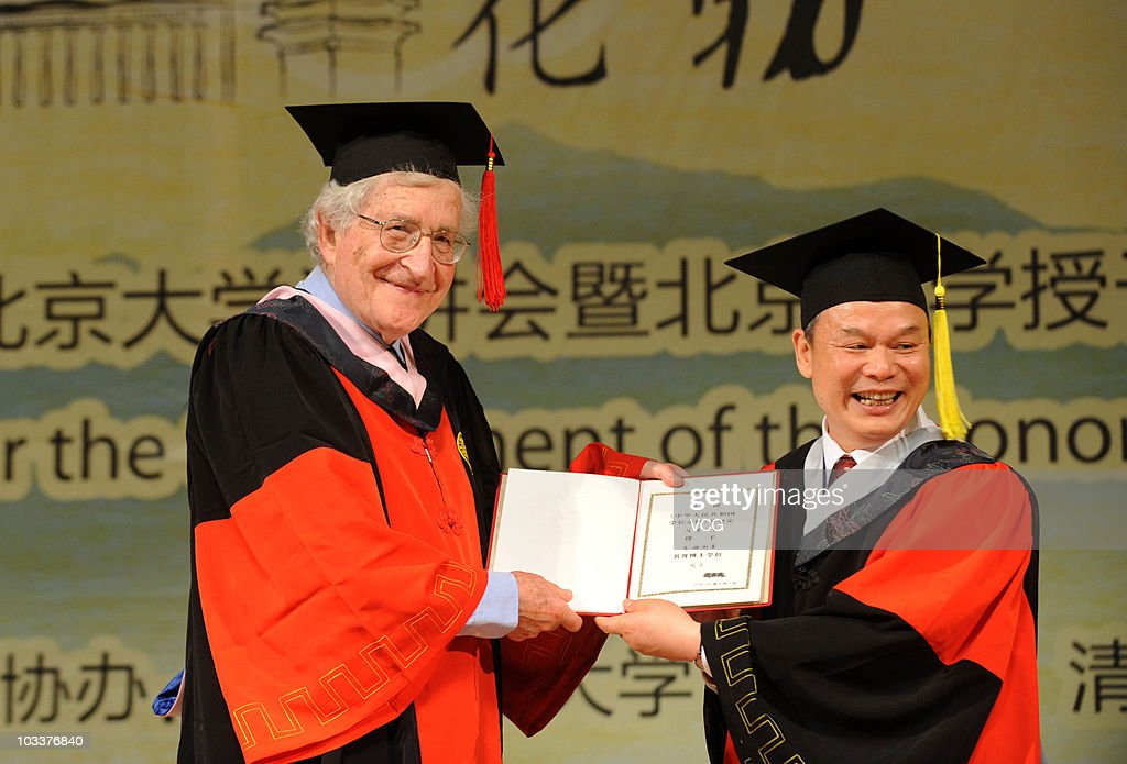 Peking University Ppresident Zhou Qifeng (R) awards <a gi-track='captionPersonalityLinkClicked' href=/galleries/search?phrase=Noam+Chomsky&family=editorial&specificpeople=635340 ng-click='$event.stopPropagation()'>Noam Chomsky</a> the educational level certificate during the ceremony for the conferment of the Honorary Doctorate at Peking University on August 13, 2010 in Beijing, China.