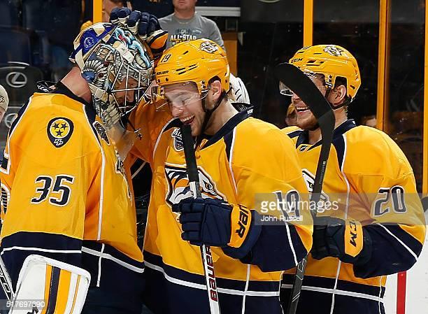 Pekka Rinne and Calle Jarnkrok of the Nashville Predators celebrate a 51 win against the Columbus Blue Jackets during an NHL game at Bridgestone...