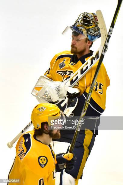 Pekka Rinne and Filip Forsberg of the Nashville Predators react after falling to the Pittsburgh Penguins 20 in Game Six of the 2017 NHL Stanley Cup...