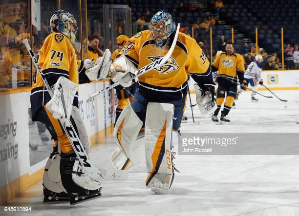 Pekka Rinne and Juuse Saros of the Nashville Predators skate in warmups prior to an NHL game against the Edmonton Oilers at Bridgestone Arena on...
