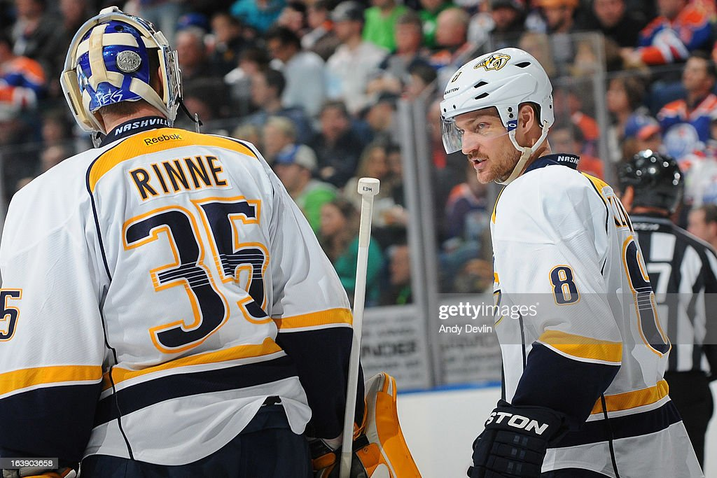 <a gi-track='captionPersonalityLinkClicked' href=/galleries/search?phrase=Pekka+Rinne&family=editorial&specificpeople=2118342 ng-click='$event.stopPropagation()'>Pekka Rinne</a> #35 and Kevin Klein #8 of the Nashville Predators exchange words between play in a game against the Edmonton Oilers on March 17, 2013 at Rexall Place in Edmonton, Alberta, Canada.