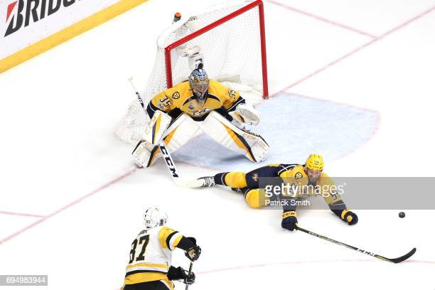 Pekka Rinne and Roman Josi of the Nashville Predators defends Sidney Crosby of the Pittsburgh Penguins in Game Six of the 2017 NHL Stanley Cup Final...