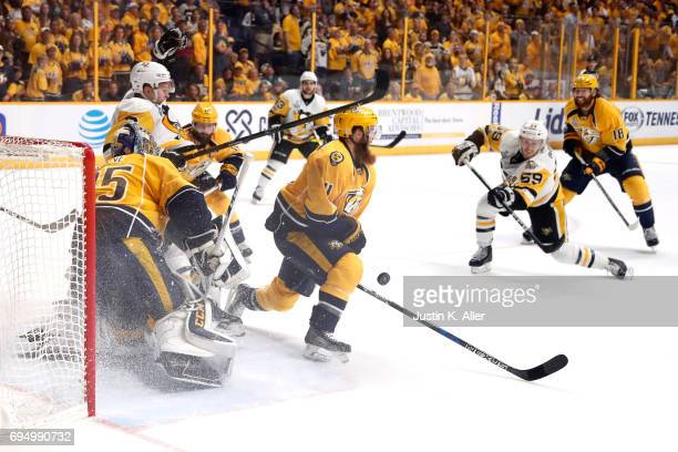 Pekka Rinne and Ryan Ellis of the Nashville Predators defend a shot by Jake Guentzel of the Pittsburgh Penguins during the second period in Game Six...