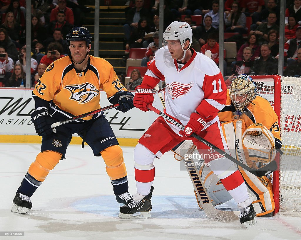 Pekka Rinne and Scott Hannan of the Nashville Predators defend against Dan Cleary of the Detroit Red Wings during a NHL game at Joe Louis Arena on...