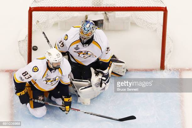 Pekka Rinne and Vernon Fiddler of the Nashville Predators react to a goal by Scott Wilson of the Pittsburgh Penguins during the third period in Game...