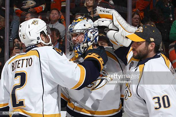 Pekka Rinne Carter Hutton and Anthony Bitetto of the Nashville Predators congratulate each other after their win in Game Seven of the Western...