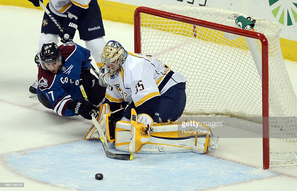 Pekka Rinne, goalie of Nashville Predators, (#35), right, saves the goal by Colorado Avalanche Aaron Palushaj (#17) in the 2nd period of the game at Pepsi Center. Denver, Colorado. March 30, 2013.